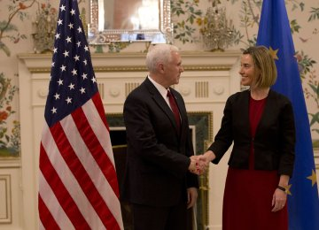 Mike Pence (L) and Federica Mogherini meet at US ambassador's residence in Brussels, Belgium, on Feb. 20.