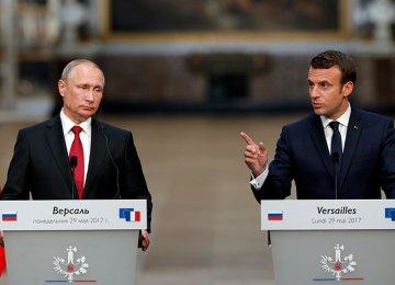 Vladimir Putin (L) and Emmanuel Macron met at Versailles Palace,  near Paris, on May 29.