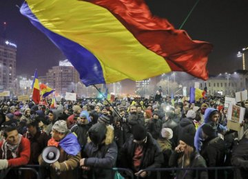 A man waves the Romanian flag during one of the protests.
