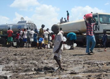 People receive rations of water at the UN compound  in the Tomping area in Juba.