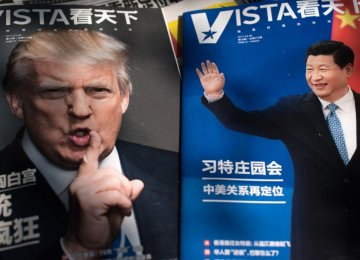 Chinese president Xi Jinping (R) and his US counterpart, Donald Trump, on magazine covers in China