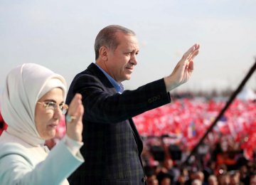 Turkish President Recep Tayyip Erdogan and his wife attend the rally in Istanbul on April 8.