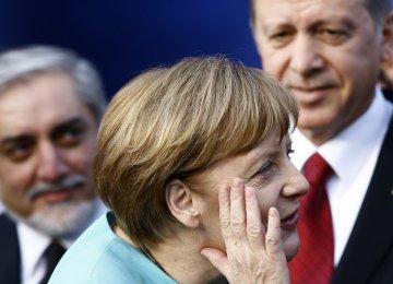 (L–R) Abdullah Abdullah, Angela Merkel and Recep Tayyip Erdogan (File Photo)