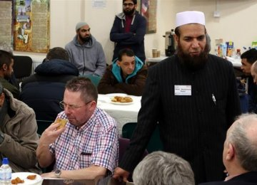 "Tea and South Asian pastries were on offer for those who participated in the ""Visit My Mosque"" project across Britain on Feb. 5."