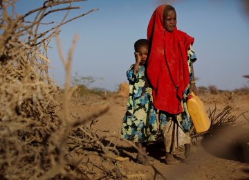 Six-year-old Tirig with her sister Saua in Burao, Somalia (File Photo)