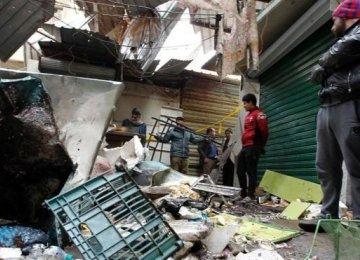 Baghdad Blasts  Kill Dozens