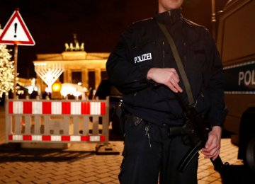 German police provide security at the Brandenburg Gate, ahead of the upcoming New Year's Eve celebrations in Berlin, Germany, on Dec 27.