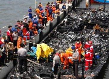 The wreckage of the burned passenger boat