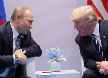 US President Donald Trump (R) and his Russian counterpart Vladimir Putin met during a meeting at the G20 Summit, July 7, 2017, in Hamburg, Germany.