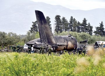 Rescuers are seen around the wreckage of the Algerian army plane which crashed near the Boufarik airbase  on April 11.