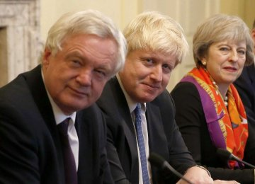 (From R-L) British Premier Theresa May, Boris Johnson and David Davis (File Photo)