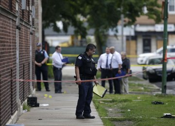 Chicago Police officers and detectives investigate  a shooting where multiple people were shot on Aug. 5.