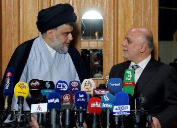 Iraqi Prime Minister Haider al-Abadi (R) attends  a press conference with Iraqi Shia cleric and leader Muqtada al-Sadr in Najaf on June 23.