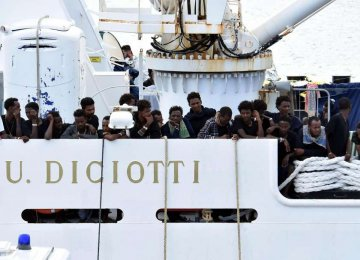 Migrants Disembark After Standoff as Italy's Salvini Faces Probe