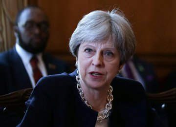May Apologizes to Caribbean States on UK Treatment of Post-War Migrants