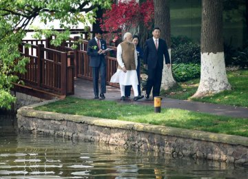 India's Prime Minister Narendra Modi (L) speaks with Chinese President Xi Jinping at the East Lake in Wuhan, China on April 28.