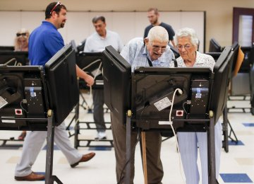 Voters cast their ballots among an array of electronic voting machines in a polling station at the Noor Islamic Cultural Center  in Dublin, Ohio, on August 7.