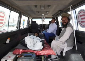 An injured boy rides in an ambulance on the Ghazni highway, in Maidan Shar, west of Kabul, Afghanistan, on August 13.