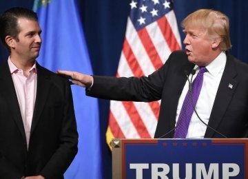 Donald Trump (R) and his son Donald Jr. (File Photo)