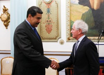 Venezuela's President Nicolas Maduro (L) meets  with US Senator Bob Corker at Miraflores Palace  in Caracas, Venezuela on May 25.