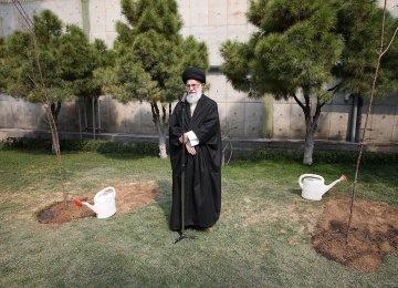 Ayatollah Seyyed Ali Khamenei plants saplings in Tehran on March 8.
