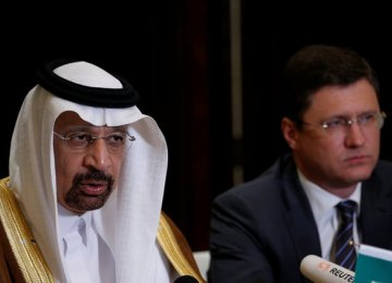 Saudi Arabia's Energy Minister Khalid al-Falih (L) and Russia's Energy Minister Alexander Novak attend a joint briefing in Beijing, 15 May.