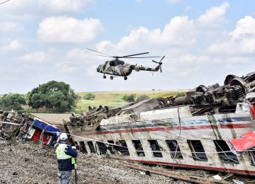 A helicopter flies over the site where a train derailed at Corlu district in Tekirdag, northwest Turkey, on July 9. (Photo: AFP)