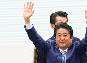 Japan's Prime Minister Shinzo Abe waves to the audience following his speech during an election campaign in Tokyo.