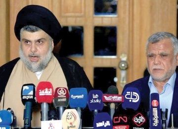 Moqtada al-Sadr speaks during a news conference with the Leader of the Conquest Coalition Hadi al-Amiri, in Najaf, Iraq on June 12.