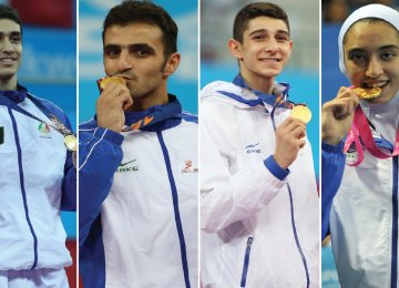 Mehdi Khodabakhshi (L), Masoud Hajizavareh (second L) and Farzan Ashourzadeh (second R) are among the world top 10 ranking of men taekwondokas in their respective weight categories and Kimia Alizadeh is fifteenth in the women's list of -62 kg group.