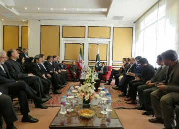 High-level Iranian and Pakistani officials confer on Dec. 25 in Islamabad.