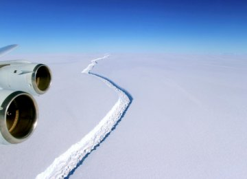A rift across the Larsen C Ice Shelf that had grown longer and deeper is seen during an airborne survey of changes in polar ice over the Antarctic Peninsula.