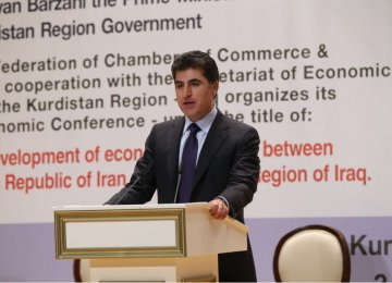 Prime Minister of Iraqi Kurdish Regional Government Nechirvan Barzani addresses a conference on developing economic ties between Iran and KRG in Erbil, Iraq, on May 2.