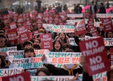 Thousands demand peace in anti-Trump protest in South Korea, Nov. 7.