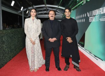 Malavika Mohanan (L), Majid Majidi (C) and Ishaan Khattar on the red carpet of the 61st London Film Festival, October 13.