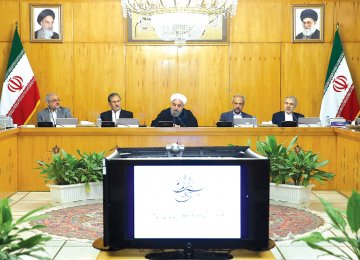 President Hassan Rouhani (C) addresses a government session in Tehran, July 19, 2017.