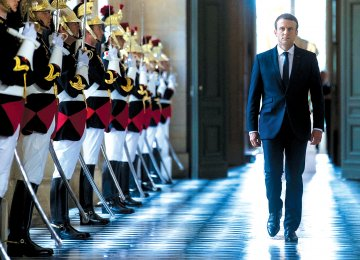 French President Emmanuel Macron walks through the Galerie des Bustes for a special gathering of both houses of parliament outside Paris, on July 3.