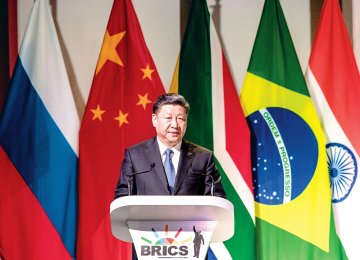 China's President Xi Jinping addresses delegates at a Business Forum organized during the 10th BRICS summit on July 25 at the Sandton Convention Centre in Johannesburg, South Africa.