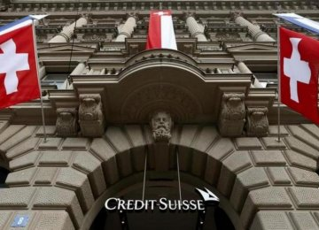 Credit Suisse Cuts World Wealth Outlook