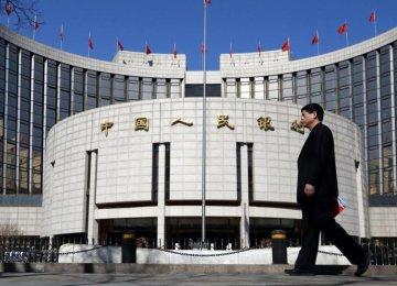China  Cuts Rates, Reserve  Ratio
