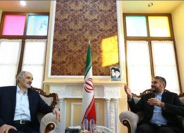 Syria's UN envoy, Bashar al-Jaafari (L), met Iranian parliamentary advisor, Hossein Amir-Abdollahian, in Tehran on Dec. 28.
