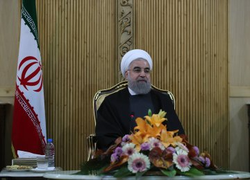 President Hassan Rouhani arrives at Tehran's Mehrabad International Airport on Dec. 23 after returning from a tour  of Central Asia and Caucasus.