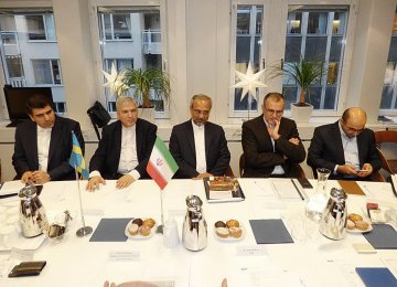 Iranian delegation headed by Mohammad Nahavandian (C)  is working to further banking ties with Sweden.