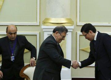 Valiollah Seif (L), Akishev Daniyar Talgatovich (R) agreed to establish correspondent relations between the commercial banks of Iran and Kazakhstan.