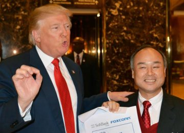 Donald Trump (L) and Masayoshi Son  in New York on Tuesday.