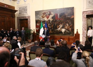 Italy's Prime Minister Matteo Renzi announces his resignation during a press conference at the Palazzo Chigi following the results of the vote for a referendum on constitutional reforms, on December 5, in Rome.