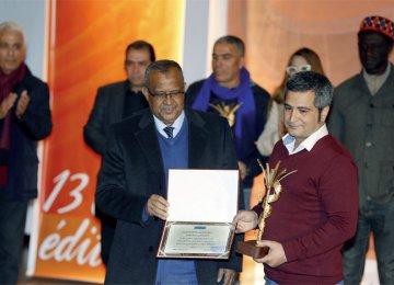Hamed Rajabi (R) receiving  the Zagora Grand Prize