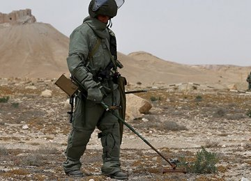 A Russian specialist clearing Aleppo of mines