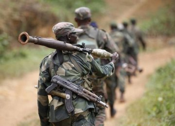 DR Congo military personnel patrol near Beni  in North Kivu Province.