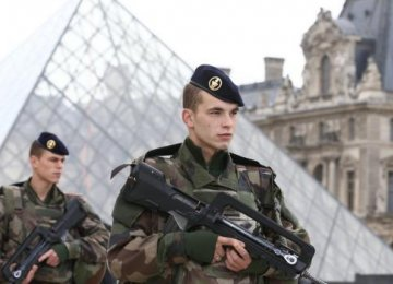Soldiers patrol in the courtyard of the Louvre Museum in Paris. (File Photo)